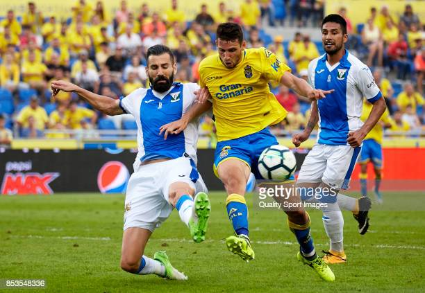 Jonathan Calleri of Las Palmas competes for the ball with Dimitrios Siovas of Leganes during the La Liga match between Las Palmas and Leganes at...