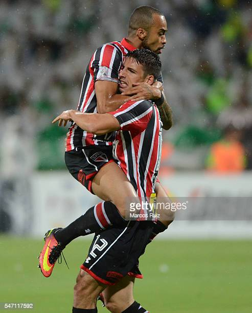 Jonathan Calleri of Sao Paulo celebrates with teammate Wesley after scoring the opening goal during a second leg semi final match between Atletico...