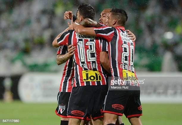 Jonathan Calleri of Sao Paulo celebrates with teammates after scoring the opening goal during a second leg semi final match between Atletico Nacional...