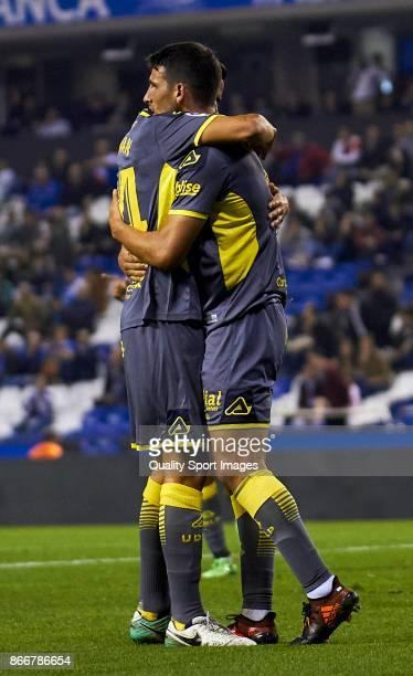 Jonathan Calleri of UD Las Palmas celebrates after scoring the fourth goal with Hernan Santana of UD Las Palmas during the Copa del Rey first leg...