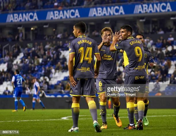 Jonathan Calleri of UD Las Palmas celebrates after scoring the fourth goal with Sergi Samper of UD Las Palmas during the Copa del Rey first leg match...