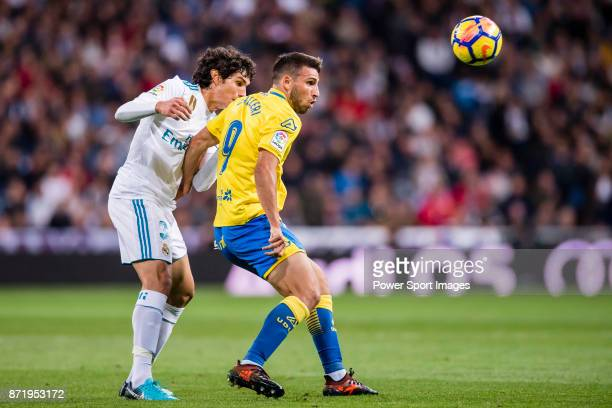 Jonathan Calleri of UD Las Palmas fights for the ball with Jesus Vallejo Lazaro of Real Madrid during the La Liga 201718 match between Real Madrid...