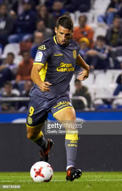 Jonathan Calleri of UD Las Palmas shots on goal and scores the third goal during the Copa del Rey first leg match between Deportivo de La Coruna and...