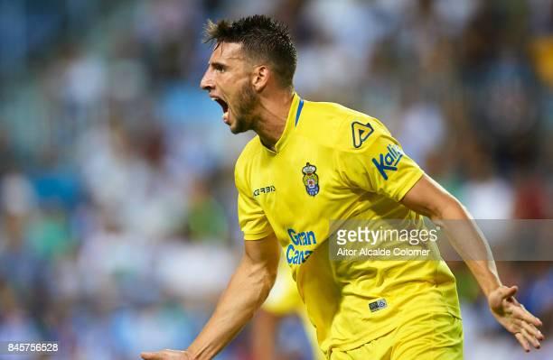 Jonathan Calleri of Union Deportiva Las Palmas celebrates after scoring during the La Liga match between Malaga and Las Palmas at Estadio La Rosaleda...