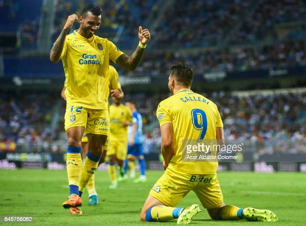 Jonathan Calleri of Union Deportiva Las Palmas celebrates after scoring with Michel Macedo of Union Deportiva Las Palmas during the La Liga match...