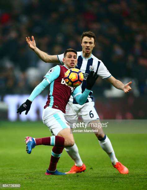 Jonathan Calleri of West Ham United and Jonny Evans of West Bromwich Albion compete for the ball during the Premier League match between West Ham...