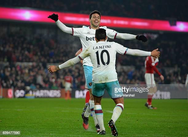 Jonathan Calleri of West Ham United celebrates scoring their third goal with Manuel Lanzini of West Ham United during the Premier League match...