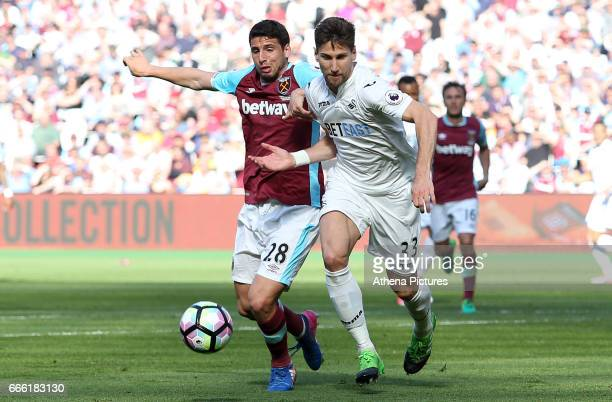 Jonathan Calleri of West Ham United challenges Federico Fernandez of Swansea City during the Premier League match between West Ham United and Swansea...