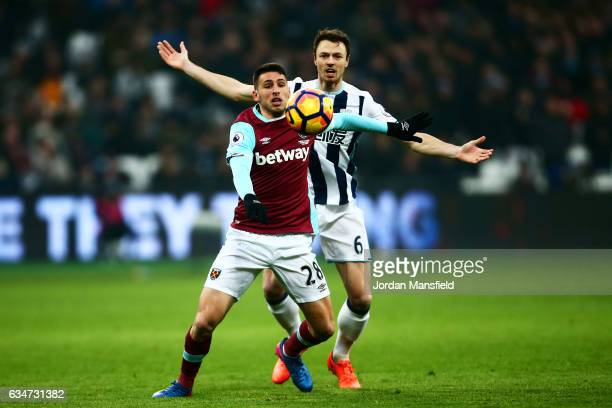 Jonathan Calleri of West Ham United controls the ball under pressure of Jonny Evans of West Bromwich Albion during the Premier League match between...
