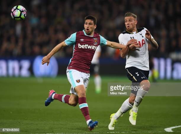 Jonathan Calleri of West Ham United is challenged by Toby Alderweireld of Tottenham Hotspur during the Premier League match between West Ham United...