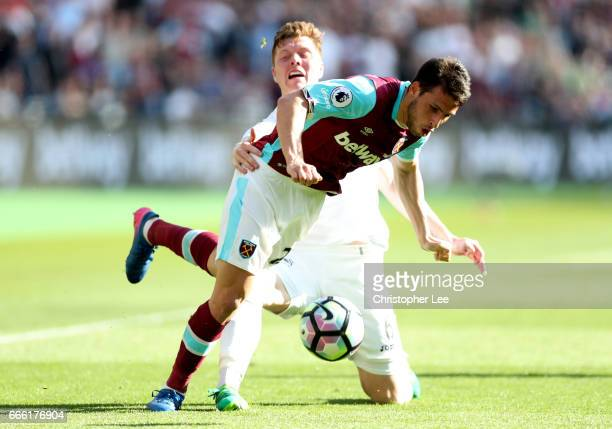 Jonathan Calleri of West Ham United is tackled by Alfie Mawson of Swansea City during the Premier League match between West Ham United and Swansea...