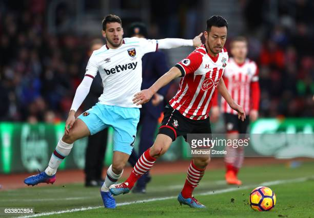 Jonathan Calleri of West Ham United puts pressure on Maya Yoshida of Southampton during the Premier League match between Southampton and West Ham...