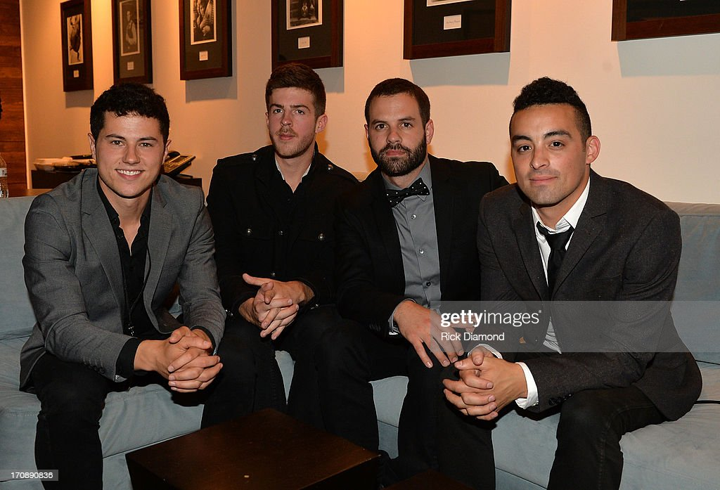 Jonathan Capeci, Drew Scheuer, Anthony Genca, and Joey Beretta of Dinner and a Suit pose during the MTV, VH1, CMT & LOGO 2013 O Music Awards at the CMT office on June 19, 2013 in Nashville, Tennessee.