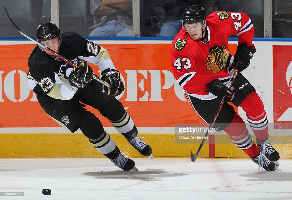 Jonathan Carlsson #43 of the Chicago Black Hawks and Alex Smigelski #23 of the Pittsburgh Penguins chase after the puck in a game during the NHL Rookie Tournament on September 14,2010 at the John Labatt Centre in London,Ontario. The Hawks defeated the Penguins 9-5.