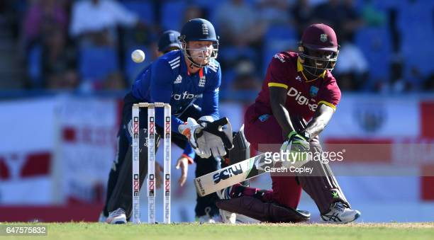 Jonathan Carter of the West Indies bats during the first One Day International between the West Indies and England at Sir Vivian Richards Cricket...