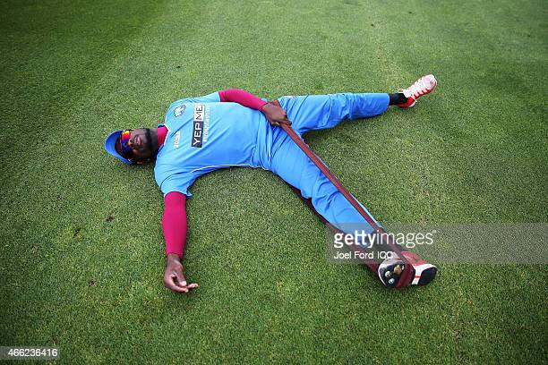 Jonathan Carter of West Indies stretches prior to the 2015 ICC Cricket World Cup match between the West Indies and United Arab Emirates at McLean...