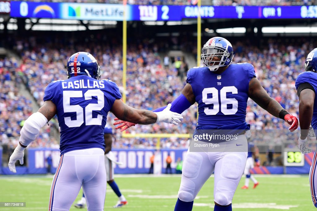 ea2886b3d ... Jonathan Casillas 52 and Jay Bromley 96 of the New York Giants  celebrate the Youth Nike ...