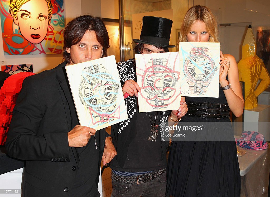 Jonathan Cheban, artist Alec Monopoly and model Karolina Kurkova attend the Haute Living and Roger Dubuis dinner hosted by Daphne Guinness at Azur on December 5, 2012 in Miami Beach, Florida.