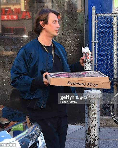 Jonathan Cheban donates a box of NY pizza to a homeless person in Midtown Manhattan for NY Pizza on May 15 2017 in New York City