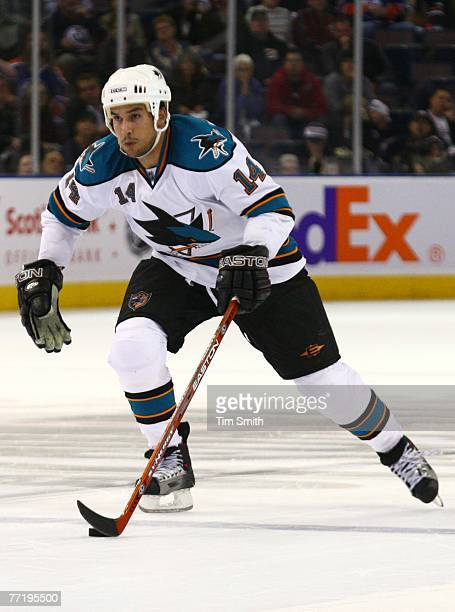 Jonathan Cheechoo of the San Jose Sharks carries the puck up the ice against the Edmonton Oilers during the Oilers home opener on October 4 2007 at...