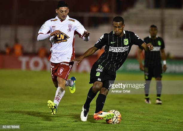 Jonathan Copete of Altetico Nacional fights for the ball with Cristian Espinoza of Huracan during a first leg match between Huracan and Atletico...