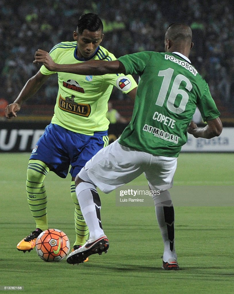 Jonathan Copete player of Nacional vies for the ball with Josue Estrada of Sporting Cristal during a group stage match between Atletico Nacional and Sporting Cristal as part of Copa Libertadores 2016 at Atanasio Girardot Stadium on March 01, 2016 in Medellin, Colombia.