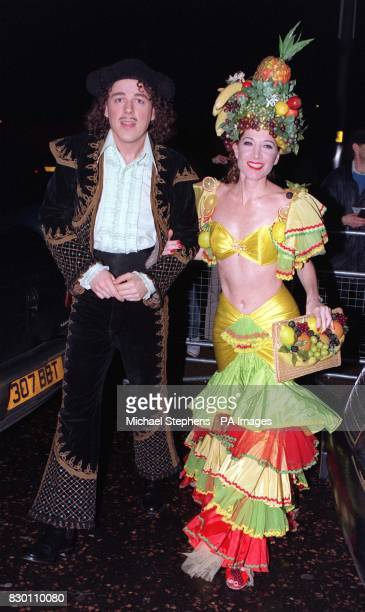 Jonathan Creek star comedian and actor Alan Davies dressed as a Spanish matador and his girlfriend dressed as Carmen Miranda American singer...