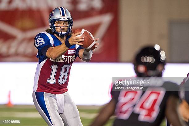 Jonathan Crompton of the Montreal Alouettes catches the ball during the CFL game against the Ottawa Redblacks at Percival Molson Stadium on August 29...