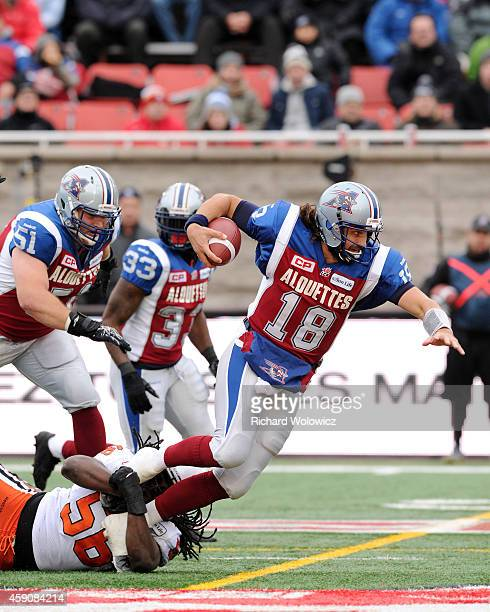Jonathan Crompton of the Montreal Alouettes is tackled by Solomon Elimimian of the BC Lions during the CFL Eastern Division SemiFinal game at...