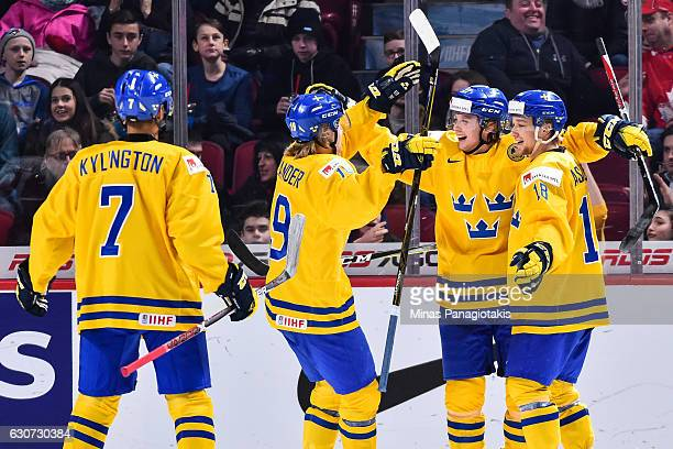 Jonathan Dahlen of Team Sweden celebrates his third goal of the match with teammates during the 2017 IIHF World Junior Championship preliminary round...