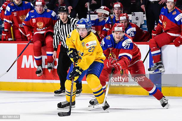 Jonathan Dahlen of Team Sweden skates against Denis Guryanov of Team Russia during the 2017 IIHF World Junior Championship bronze medal game at the...