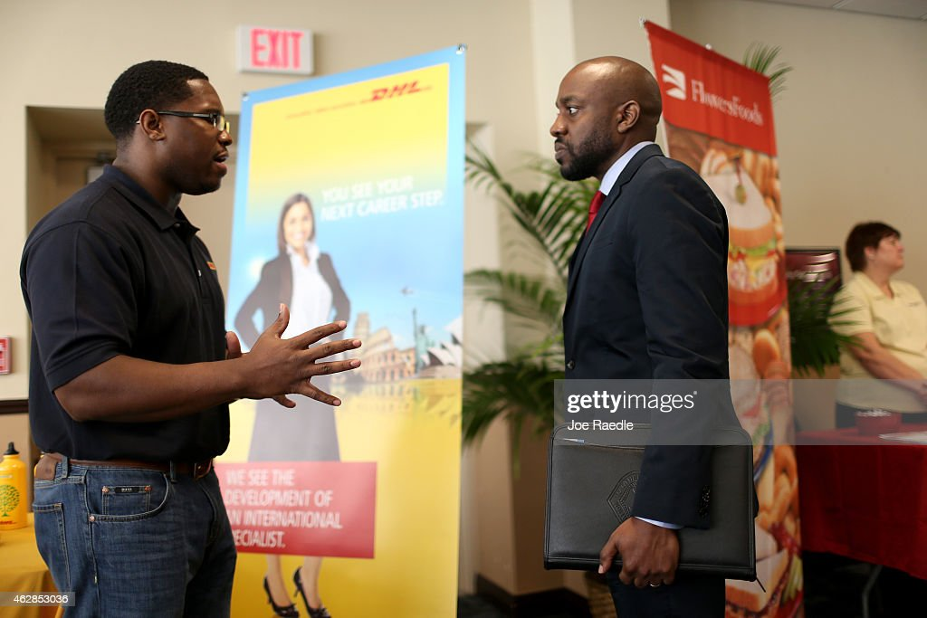 Jonathan Danner a recruiter for DHL speaks with US military veteran Arlington Robertson as he explains the jobs available during the Veterans Career...