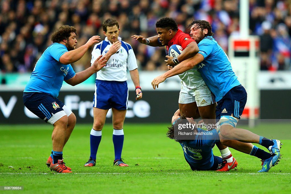 Jonathan Danty of France is tackled by Michele Campagnaro and Valerio Bernabo of Italy during the RBS Six Nations match between France and Italy at Stade de France on February 6, 2016 in Paris, France.