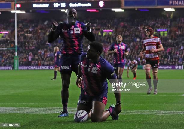 Jonathan Danty of Stade Francais is congratulated by teammate Djibril Camara after scoring his team's second try during the European Rugby Challenge...