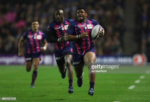Jonathan Danty of Stade Francais runs in his team's second try during the European Rugby Challenge Cup Final between Gloucester and Stade Francais at...