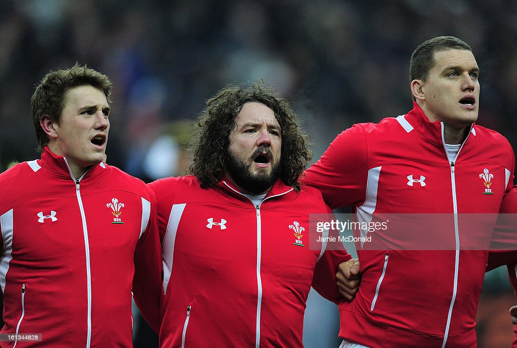 Jonathan Davies, Adam Jones and Ian Evans of Wales sing the national anthem during the RBS Six Nations match between France and Wales at Stade de France on February 9, 2013 in Paris, France.