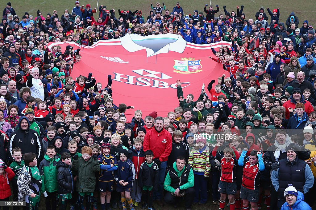 Jonathan Davies ambassador for HSBC poses with children and families during the HSBC Brecon RFC Mini-Rugby Festival on April 1, 2013 in Brecon, Wales.