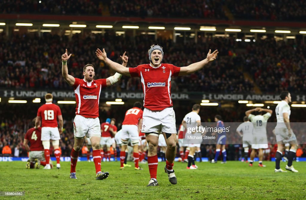 Jonathan Davies and Alex Cuthbert of Wales celebrate winning the Championship after the RBS Six Nations match between Wales and England at Millennium...
