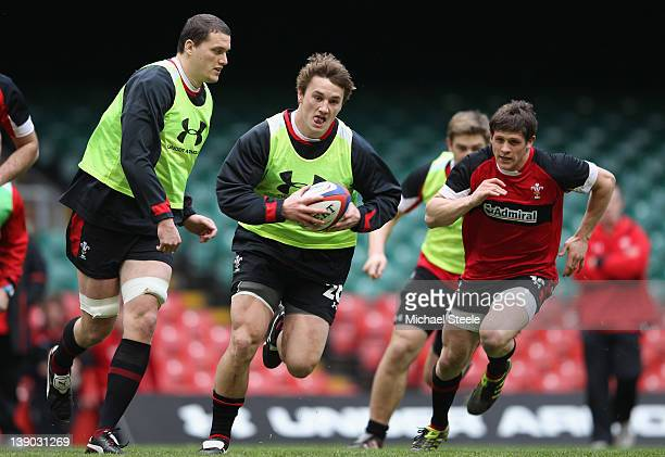 Jonathan Davies cuts between Lloyd Williams and Ian Evans during the Wales Rugby Training session at the Millennium Stadium on February 15 2012 in...