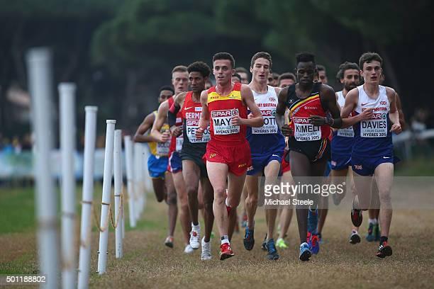 Jonathan Davies of Great Britain eventual winner alongside Isaac Kimeli of Belgium and Carlos Mayo of Spain in the U23 Men's race during the Spar...