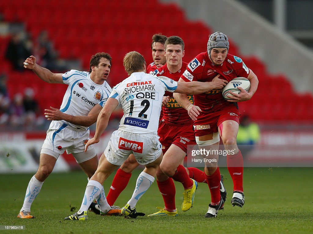 Jonathan Davies of Scarlets charges through the Exeter defence during the Heineken Cup match between Scarlets and Exeter Chiefs at Parc y Scarlets on December 8, 2012 in Llanelli, Wales.