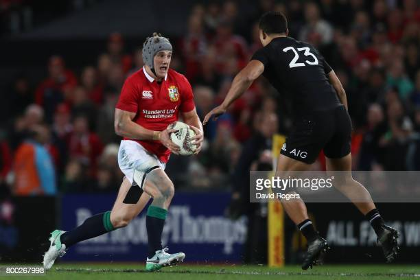 Jonathan Davies of the Lions charges towards Anton LienertBrown of the All Blacks during the first test match between the New Zealand All Blacks and...
