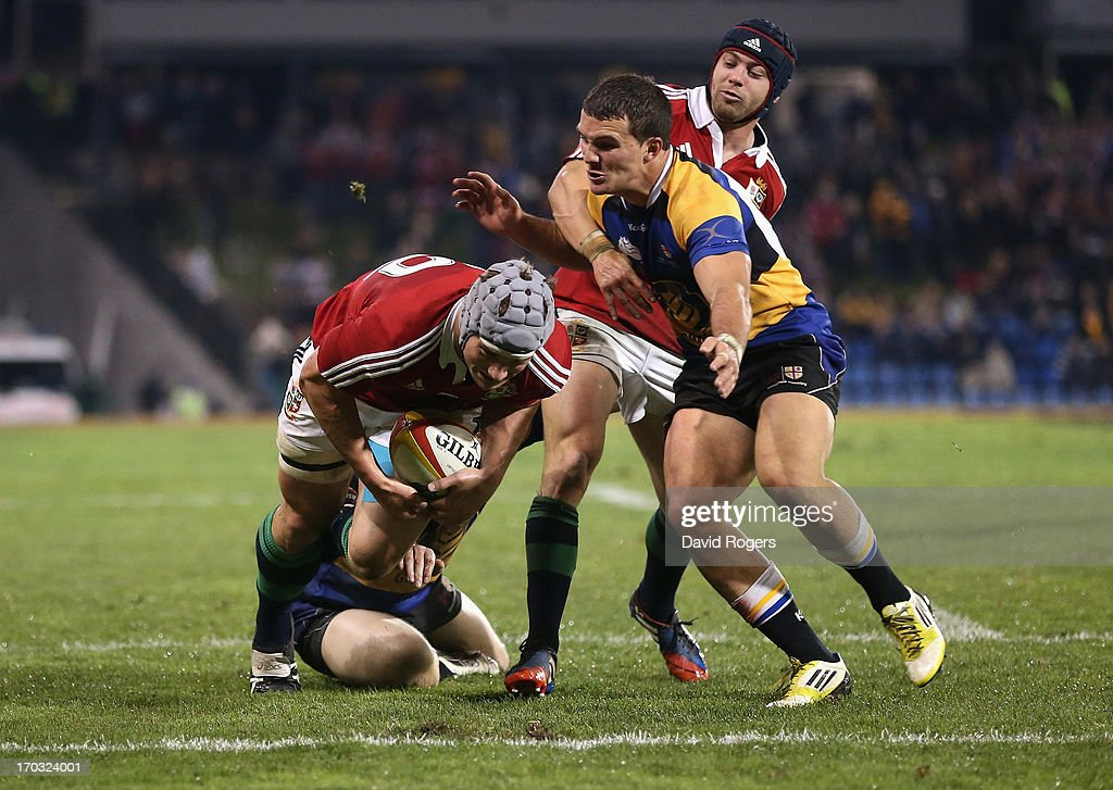 Jonathan Davies of the Lions dives over for a try during the match between Combined Country and the British & Irish Lions at Hunter Stadium on June 11, 2013 in Newcastle, Australia.