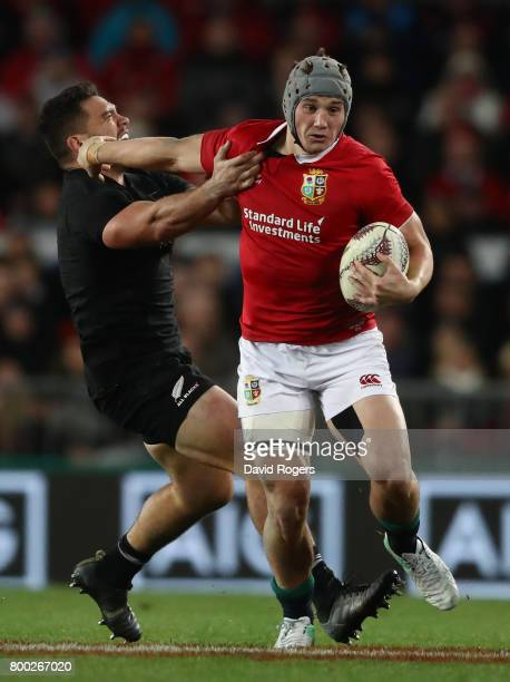 Jonathan Davies of the Lions hands off Anton LienertBrown of the All Blacks during the first test match between the New Zealand All Blacks and the...