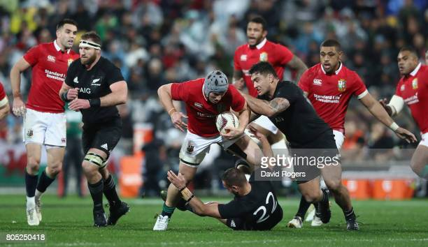 Jonathan Davies of the Lions is tackled during the match between the New Zealand All Blacks and the British Irish Lions at Westpac Stadium on July 1...