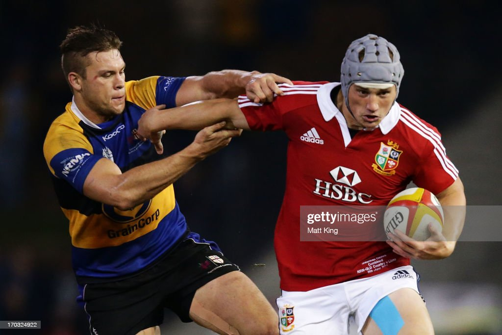 Jonathan Davies of the Lions takes on the defence during the match between Combined Country and the British & Irish Lions at Hunter Stadium on June 11, 2013 in Newcastle, Australia.