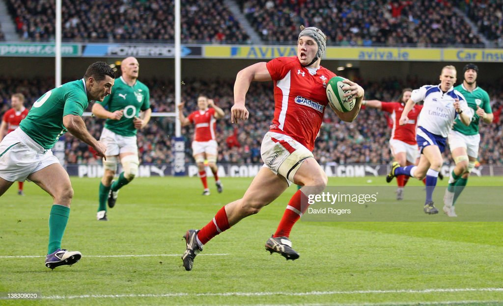 Jonathan Davies of Wales breaks clear to score his second try during the RBS Six Nations match between Ireland and Wales at the Aviva Stadium on February 5, 2012 in Dublin, Ireland