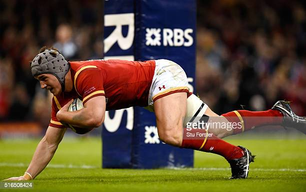 Jonathan Davies of Wales goes over to score his team's third try during the RBS Six Nations match between Wales and Italy at the Principality Stadium...