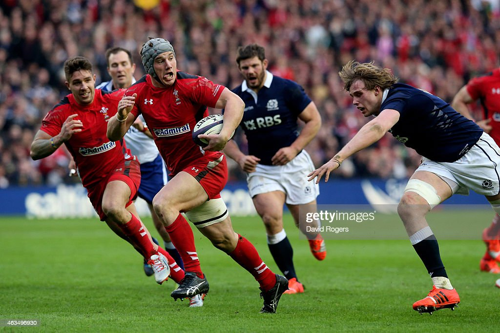 <a gi-track='captionPersonalityLinkClicked' href=/galleries/search?phrase=Jonathan+Davies+-+Rugby+Union+Player+-+Born+1988&family=editorial&specificpeople=8522336 ng-click='$event.stopPropagation()'>Jonathan Davies</a> of Wales goes past <a gi-track='captionPersonalityLinkClicked' href=/galleries/search?phrase=Richie+Gray+-+Rugby+Player&family=editorial&specificpeople=5907993 ng-click='$event.stopPropagation()'>Richie Gray</a> of Scotland to score his team's second try during the RBS Six Nations match between Scotland and Wales at Murrayfield Stadium on February 15, 2015 in Edinburgh, Scotland.