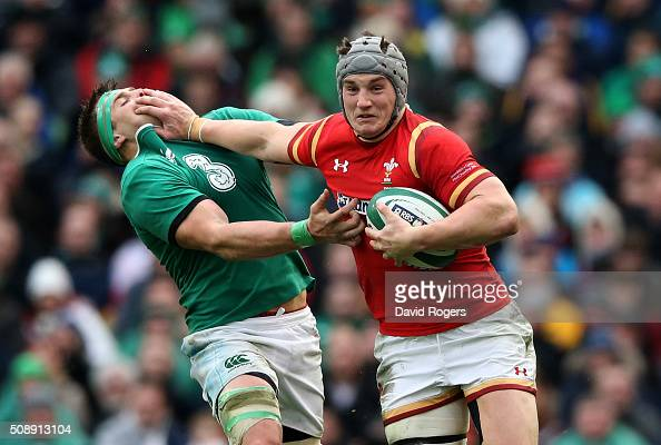 Jonathan Davies of Wales hands off CJ Stander of Ireland during the RBS Six Nations match between Ireland and Wales at the Aviva Stadium on February...